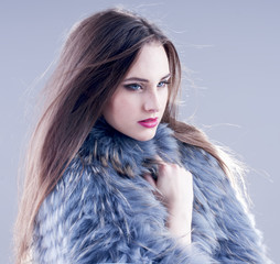 Winter fashion woman in a fur coat.