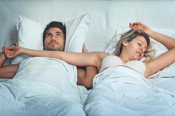 Man awake by woman snoring