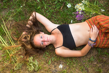 Beautiful young girl lying on the ground with her hair.