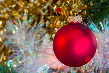 Christmas red bauble with tinsel