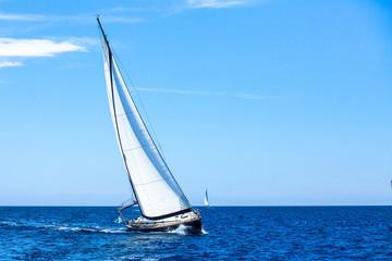 Sailing. Sailboat participate in sailing regatta. Luxury yachts.