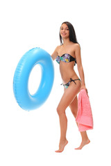 female in bikini holding swimming ring