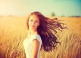 Fototapety Beautiful teenage model girl in white dress enjoying nature