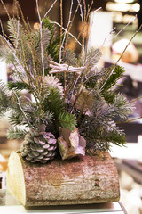 Xmas log with fir tree and branches as table center