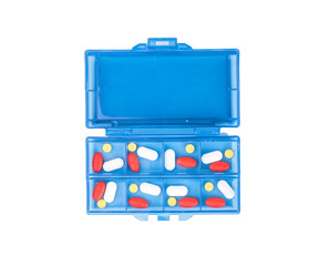 Prescription pills and vitamins in a blue pill box - days of wee