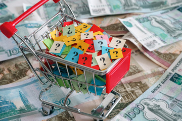 Shopping cart with question marks on russian rubles