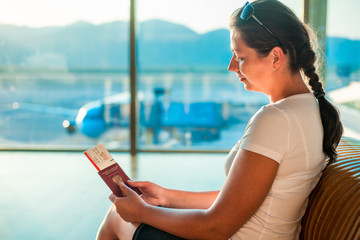 young girl with documents waiting to board the plane