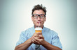 Funny man drinking from a paper cup with a straw