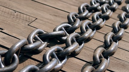 large and heavy chain lying on quay