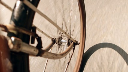 rusty wheel riding  bicycle on road