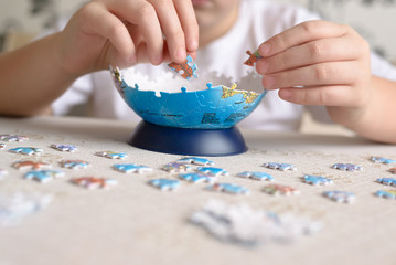 boy collects puzzles from Globe