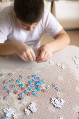Teenager boy collects puzzles from Globe