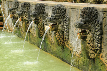 Dragon fountains spewing water at Bali hot springs