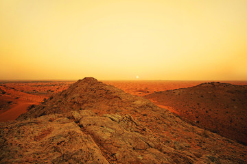 Landscape in the desert at sunset in orange tones