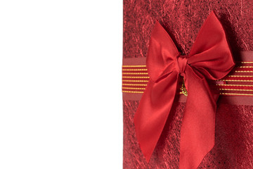 red greeting card with bow on the white background