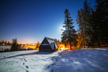 Wooden shelter in Tatra mountains at night, Poland