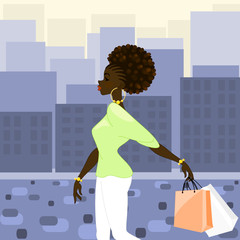 Dark-skinned woman shopping in the city
