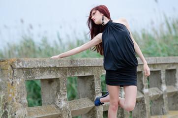 woman is standing on a bridge