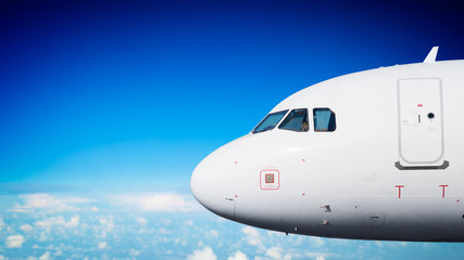 Passenger plane nose close up in flight