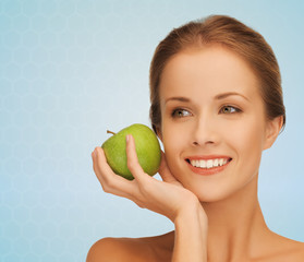smiling young woman with green apple