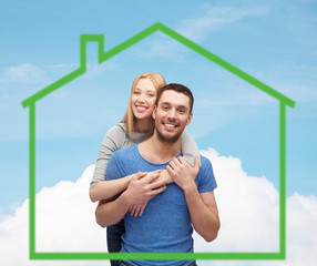 smiling couple hugging over green house