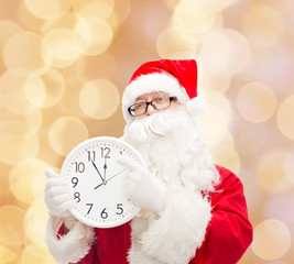 man in costume of santa claus with clock