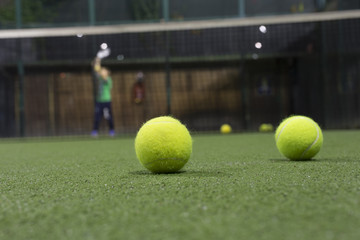 Paddle ball in astroturf court
