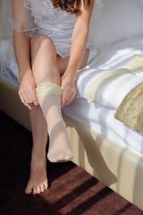 garter on the leg of the bride