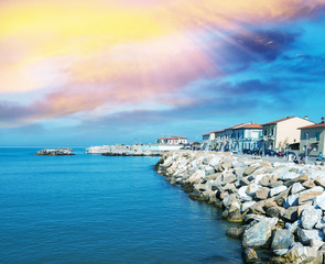 Rocks over the oceans. Beautiful seascape with village homes at