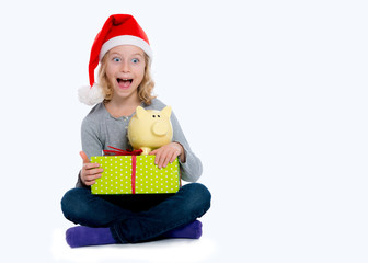 girl with Santa- cap gift and piggy bank