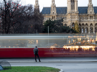 Tramway passing the Cityhall christmas Market in Vienna