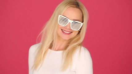 Woman with Long Blond Hair Wearing White Funny Party Glasses