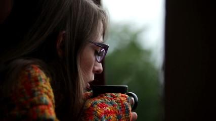 Woman holding mug of coffee