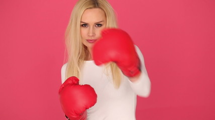 Feisty woman wearing red boxing gloves