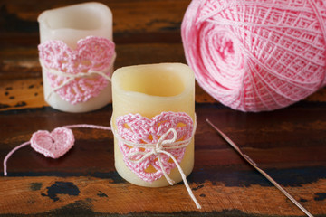 Candle with  pink crochet handmade heart for Saint Valentine's d