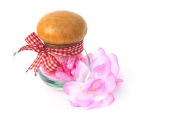 pink capsule in glass jar