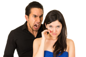 young beautiful woman crying while husband screams at her