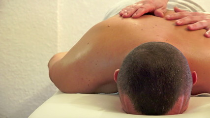 Client Receiving Body Massage at Spa Club