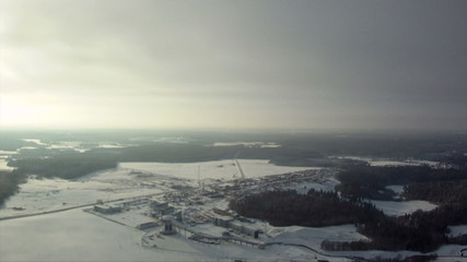 View from above of snow-covered fields and forests