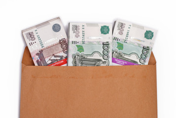 Пачки российских рублей в конверте