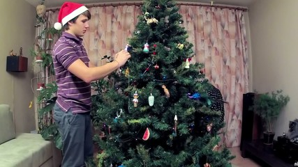 Family decorates a Christmas tree.