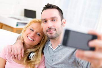 Young attractive couple having fun doing selfie
