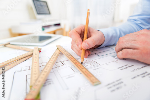 canvas print picture Close up view of an architect working at office
