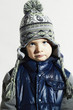 sad child.winter fashion kids.fashionable little boy in cap