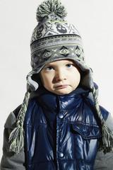 sad child.winter fashion kids.fashionable little boy in cap
