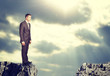 Businessman standing on the edge of rock gap - 74981578