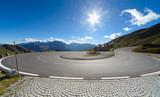Sharp U-turn on Alpine road in Austria - 74982303