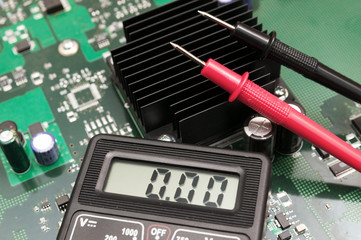 Close-up multimeter on PCB plate.