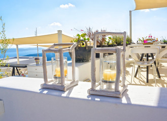 Wooden candle holders in a terrace - Santorini Greece
