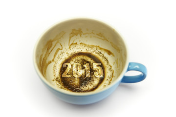 coffee cup with coffee grounds & 2015